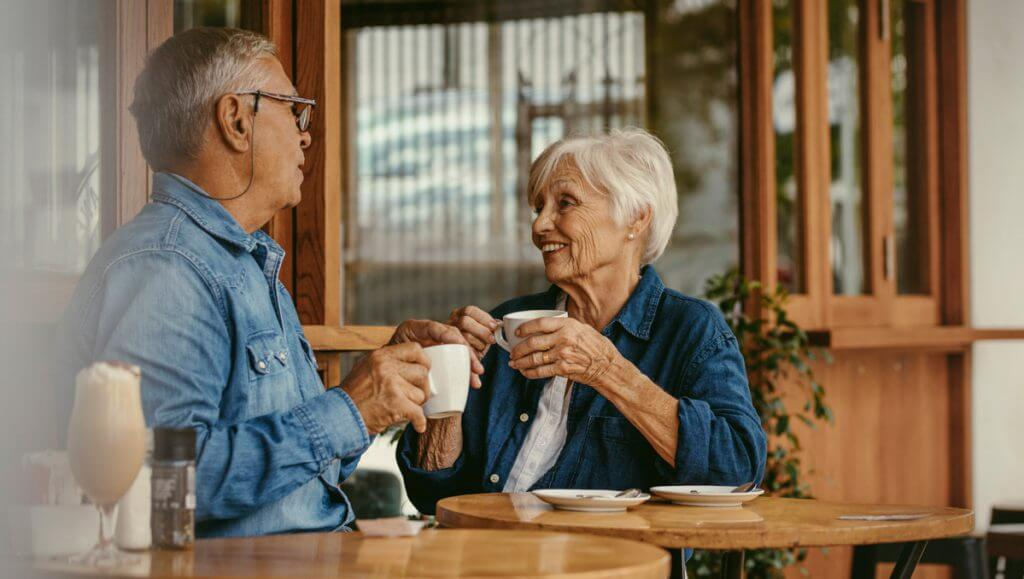 Senior couple talking over a cup of coffee
