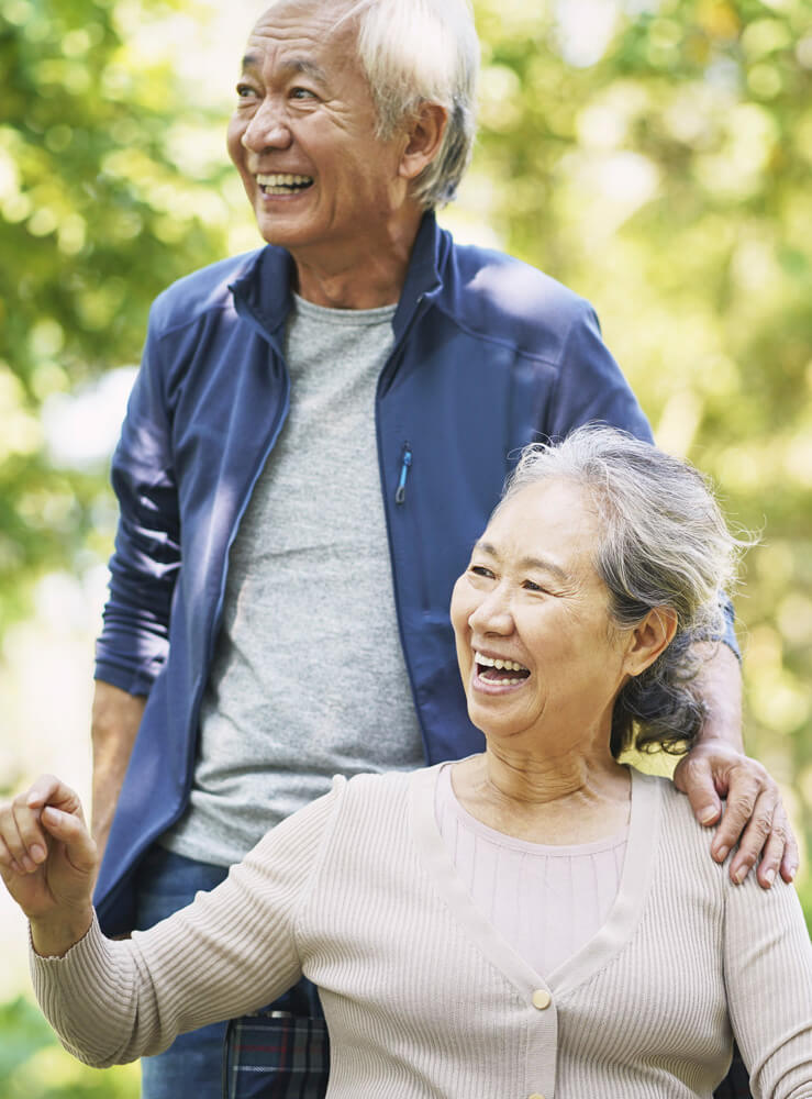 asian old couple relaxing in park